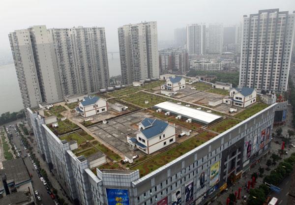 中国にあるショッピングモールの上にある住宅